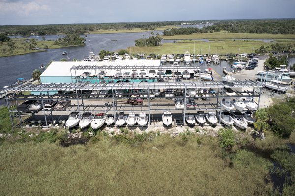 Image of Twin Rivers Marina boats docked and on racks.