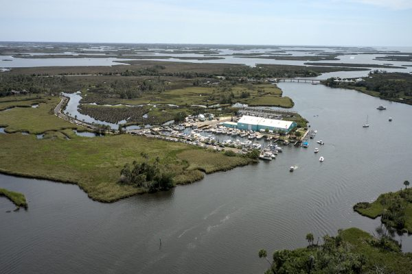 Image of the Twin Rivers Marina showing their fleet of boats and warehouse.