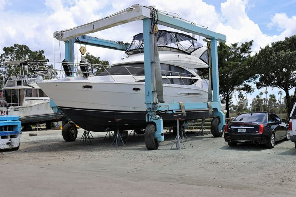 Image of a boat waiting to be serviced at the Twin Rivers Marina