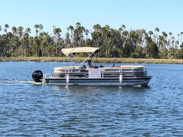 Image of the Twin Rivers Marina Adventure Boat 26' Pontoon with Bimini Coverage